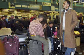 Passengers pack Tripoli's International airport  as they try to catch flights leaving Libya. European countries are sending planes and ferries to Libya to evacuate their citizens, February 22, 2011