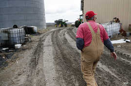 Blake Hurst, a corn and soybean farmer and president of the Missouri Farm Bureau, walks to the tractor shed on his farm in Westboro, Mo., April 4, 2017. U.S. President Donald Trump has vowed to redo the North American Free Trade Agreement, but NAFTA...