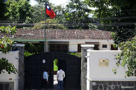 A man walks in the Taiwan embassy a day after the Salvadoran government announced that it has broken off diplomatic relations with Taiwan, in San Salvador, El Salvador, Aug. 21, 2018.