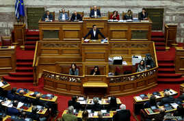 Greek Prime Minister Alexis Tsipras addresses lawmakers during a parliamentary session before a budget vote in Athens, Greece, Dec. 18, 2018.