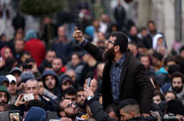 Palestinians take part in a protest against the Palestinian authority, in the West Bank city of Ramallah, March 13, 2017.