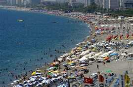Local and foreign tourists fill Konyaalti beach in Antalya, southern Turkey, Tuesday, Aug. 29, 2006, a day after the bomb attack that killed three people and injured at least 20. The Kurdistan Freedom Falcons, a hard-line Kurdish militant group, clai