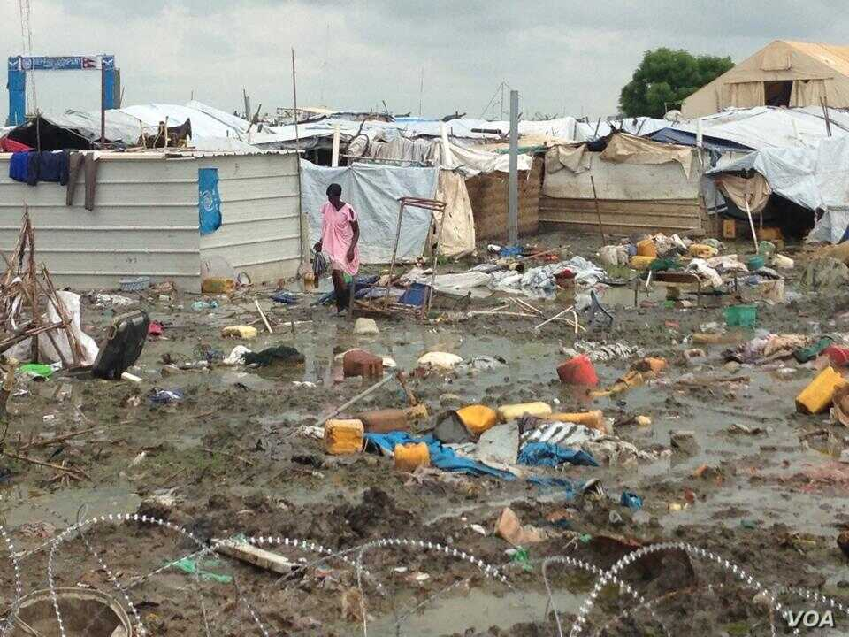 A woman walks through the UNMISS camp in Malakal, where rain has turned the dirt paths into mud.