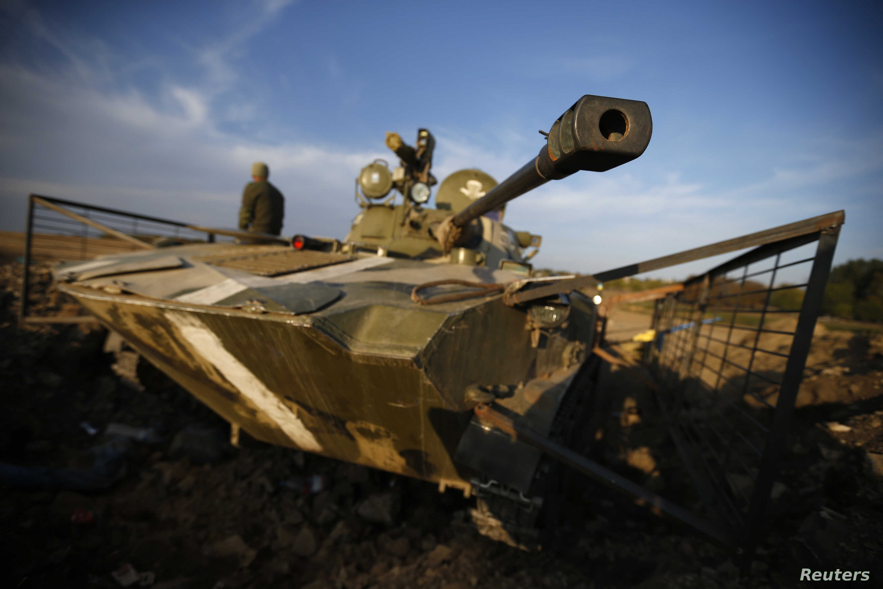 A Ukrainian soldier is pictured next to a tank near the village of Debaltseve in eastern Ukraine Sept. 21, 2014.