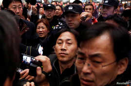North Korean national Ri Jong Chol, center, is surrounded by media after his arrival at the airport in Beijing, China, March 4, 2017.