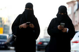 FILE - Saudi women use the Careem app on their mobile phones in Riyadh, Saudi Arabia, Jan. 2, 2017.