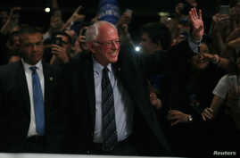 Democratic U.S. presidential candidate Senator Bernie Sanders arrives to speak to supporters on the night of the Michigan, Mississippi and other primaries at his campaign rally in Miami, Florida, March 8, 2016.