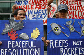 Environmental activists picket the Chinese Consulate to protest alleged military buildup by China on the disputed group of islands at the South China Sea, in Manila, Philippines, Jan. 24, 2017. The protesters condemned China's alleged installation o