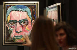 A painting by David Bowie is set up for the the David Bowie exhibition in Berlin, Germany, May 14, 2014.