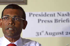 Former Maldives' President Mohammed Nasheed speaks during a press conference after the commission of national inquiry released its report in Male, Maldives, which concluded that Nasheed's resignation was legal, and not forced at gunpoint as he clai...