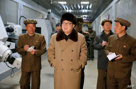 FILE - undated photo released by North Korea's official Korean Central News Agency (KCNA) on April 2, 2016 shows North Korean leader Kim Jong-Un (C) at the Tonghungsan Machine Plant.