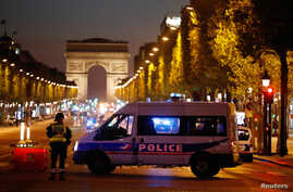 Police secure the Champs Elysees Avenue after one policeman was killed and another wounded in a shooting incident in Paris, France, April 20, 2017.