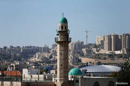 The minaret of a mosque is seen in the Palestinian neighbourhood of Beit Safafa in Jerusalem March 8, 2017.