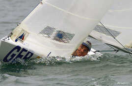 FILE - Germany's Heiko Kroeger looks out of his yacht during racing in the Individual Mens 2.4-meter class at the Paralympic Games Sailing competition on Sydney Harbour, Oct. 26, 2000.