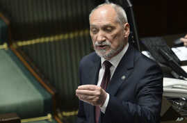 FILE - Polish Defense Minister Antoni Macierewicz speaks during a parliamentary debate in Warsaw, Poland, May 24, 2017.