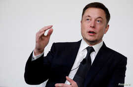 FILE - Elon Musk, founder, CEO and lead designer at SpaceX and co-founder of Tesla, speaks at the International Space Station Research and Development Conference in Washington, July 19, 2017.
