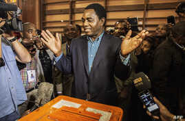 FILE -  Hakainde Hichilema of the United Party for National Development casts his ballot in Lusaka's Kabulonga suburb, Jan. 20, 2015. Zambians chose Edgar Lungu to serve the remainder of the term of President Michael Sata, who died in October 2014.