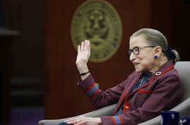 "Supreme Court Justice Ruth Bader Ginsburg waves goodbye to those who came to listen and participate in her ""fireside chat"" in the Bruce M. Selya Appellate Courtroom at the Roger William University Law School in Bristol, Rhode Island, Jan. 30, 2018."