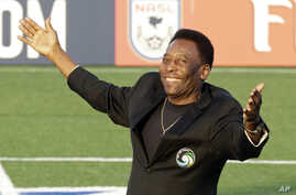 FILE - Brazilian soccer legend Pele waves to the crowd during a pregame ceremony before an NASL soccer game.
