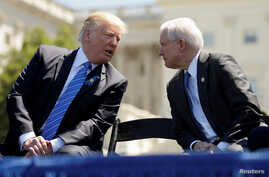 FILE - President Donald Trump speaks with Attorney General Jeff Sessions as they attend the National Peace Officers Memorial Service on the West Lawn of the U.S. Capitol in Washington, U.S.