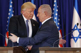 FILE - President Donald Trump shakes hands with Israeli Prime Minister Benjamin Netanyahu after making a joint statement in Jerusalem, May 22, 2017.
