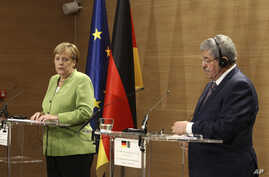 Algerian Prime Minister Ahmed Ouyahia (R) and German Chancellor Angela Merkel answer questions during a joint press conference held in Algiers, Algeria, Sept.17, 2018.