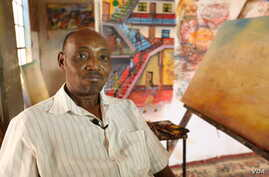 "Kenyan artist Joseph Mbatia, known as ""Bertiers,"" in his Nairobi studio, where he is working on a piece depicting a nationwide doctors' strike that has been ongoing for almost two months, Jan. 27, 2017. (VOA/J. Craig)"