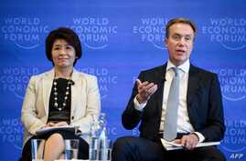 President of the World Economic Forum Borge Brende (R) gestures next to Executive Committee member Makiko Eda (L) during a press conference ahead of the 2019 edition of the annual meeting of the World Economic Forum (WEF) on Jan. 15, 2019 in Geneva.