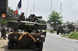 French soldiers from Operation Licorne in the Ivory Coast patrol in the 'Deux Plateaux' district of Abidjan, April 9, 2011