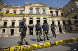 Municipality police guard the National Museum which burned the previous night in Rio de Janeiro, Sept. 3, 2018.