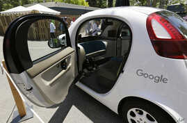 FILE - A Google self-driving car is on display at Google's I/O conference in Mountain View, Calif., May 18, 2016. Cars with no steering wheel, no pedals and nobody at all inside could be driving themselves on California roads by the end of 2017, unde
