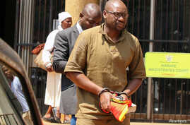 Pastor Evan Mawarire is escorted by detectives as he arrives at court to face charges of attempting to subvert the government, in Harare, Zimbabwe, Sept. 26, 2017.
