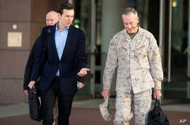 President Donald Trump's son-in-law and senior advisor Jared Kushner (L) speaks with Marine Corps Gen. Joseph F. Dunford Jr., chairman of the Joint Chiefs of Staff, before departing for Iraq from Ramstein Air Base, Germany, April 3, 2017.