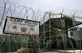 FILE - The front gate of Camp Delta is shown at the Guantanamo Bay Naval Station in Guantanamo Bay, Cuba.