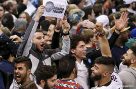 Demonstrators cheer after Republican U.S. presidential candidate Donald Trump cancelled his rally at the University of Illinois at Chicago, March 11, 2016.