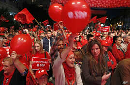 Supporters of the Social Democratic Party (SDP) wave flags and balloons during a final pre-election rally in Sarajevo, Bosnia, Oct. 9, 2014.