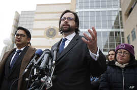 Justin Cox of the National Immigration Law Center, representing all the plaintiffs, right, with Omar Jadwat of ACLU, speaks to reporters outside the courthouse in Greenbelt, Md., March 15, 2017.