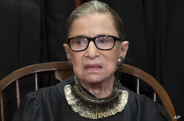 Associate Justice Ruth Bader Ginsburg sits with fellow Supreme Court justices for a group portrait at the Supreme Court Building in Washington, Nov. 30, 2018.