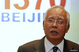 Malaysian Prime Minister Najib Razak addresses reporters about the missing Malaysia Airlines flight MH370 at Kuala Lumpur International Airport, March 15, 2014.