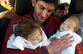 Abdul-Hamid Alyousef, 29, holds his twin babies, who were killed during a suspected chemical weapons attack, in Khan Sheikhoun in the northern province of Idlib, Syria, April 4, 2017. Alyousef also lost his wife, two brothers, nephews and many other