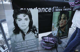 Signs in support of Michael Jackson are seen outside of the premiere of the 'Leaving Neverland' Michael Jackson documentary film at the Egyptian Theatre on Main Street during the 2019 Sundance Film Festival, Jan. 25, 2019, in Park City, Utah.
