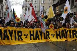 """Activists march during a protest against the Turkish government's plans to build a nuclear power plant in the country in Istanbul March 19, 2011.  The banner reads, """"No no no."""""""