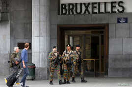 Belgian soldiers patrol outside the central train station where a suspect package was found, in Brussels, Belgium, June 19, 2016.