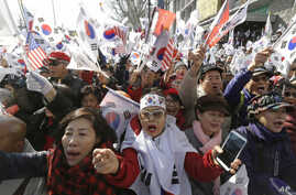 Supporters of South Korean President Park Geun-hye shout slogans during a rally opposing her impeachment near Constitutional Court in Seoul, South Korea, March 10, 2017.