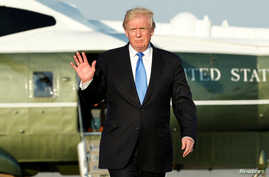 U.S. President Donald Trump waves before his departs from Newark Liberty International airport after a weekend at Trump National Golf Club in Bedminster, New Jersey, June 11, 2017.