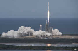 In this photo provided by NASA, the SpaceX Falcon 9 rocket, with the Dragon spacecraft onboard, launches from pad 39A at NASA's Kennedy Space Center in Cape Canaveral, Fla., June 3, 2017.