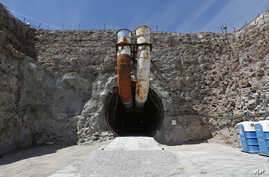 FILE - This photo shows the south portal of the proposed Yucca Mountain nuclear waste dump near Mercury, Nevada, April 9, 2015.