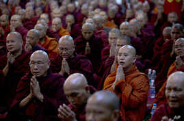 In this June 27, 2013 photo, controversial Buddhist monk Wirathu, second right foreground, who is accused of instigating sectarian violence between Buddhists and Muslims through his sermons.