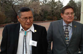 Ben Shelly, the President of the Navajo Nation, left, and Lorenzo Bates, Navajo Council Delegate walk outside the New Mexico Capitol in Santa Fe, New Mexico, Feb. 19, 2014.