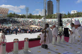 Pope Francis (R) holds his pastoral staff as he celebrates a Mass in a partially empty Tbilisi stadium, in Tbilisi, Georgia, Oct. 1, 2016. The pontiff will next visit Azerbaijan during his three-day visit to the Caucasus.